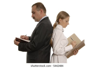 serious man and a woman with documents are writing something and are standing back close to back