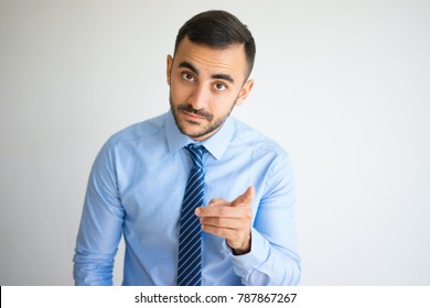 Serious Manager Raising Finger in Warning Gesture