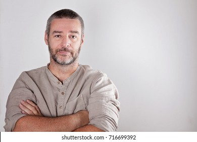 Serious mature middle aged man looking into camera