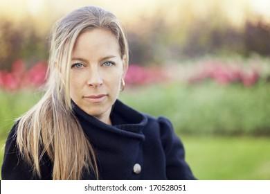 Serious mature woman looking at the camera