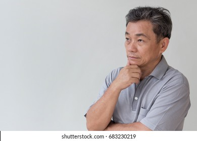 serious middle aged old senior man thinking, negative mood