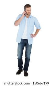 Serious model on white background posing while having a phone call