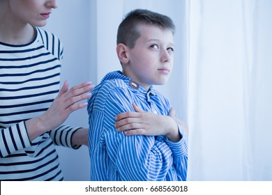 Serious mother talking to her autistic son