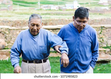 Serious native american elderly father and son in the countryside.