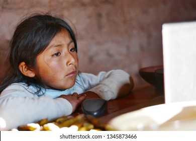 Serious native american kid using notebook.