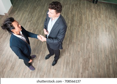 Serious Partners Meeting and Shaking Hands