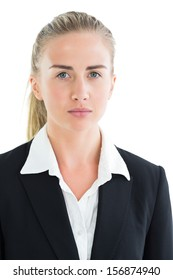 Serious ponytailed businesswoman looking at camera on white background