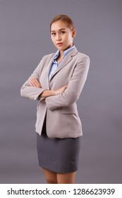 serious professional asian businesswoman; portrait of professional successful asian business woman boss crossing her arms; Southeast asian young adult woman model with light tan skin
