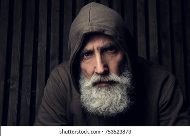 Serious senior bearded man looking at the camera. Old boxer face.
