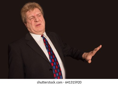 Serious senior businessman showing stop gesture
