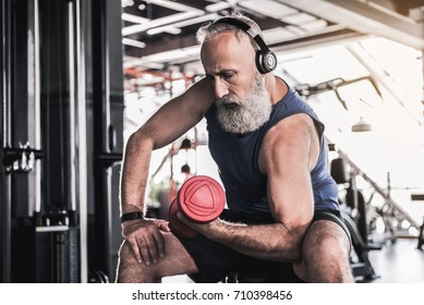 Serious senior male is enjoying sporty lifestyle