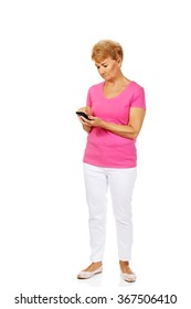Serious senior woman with smartphone