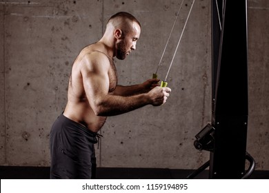 a serious sexy fit man is going to haul the ropes on the tool. arms development.amater sport