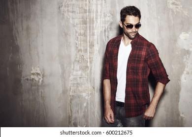 Serious shades and checked shirt guy, studio