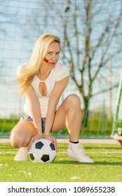 Serious Soccer Fan Girl with The Ball