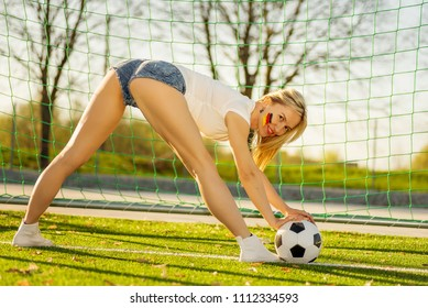 Serious Soccer Fan Girl with The Ball and football goal
