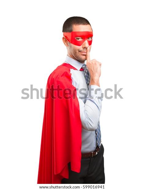 Serious super businessman silence gesture