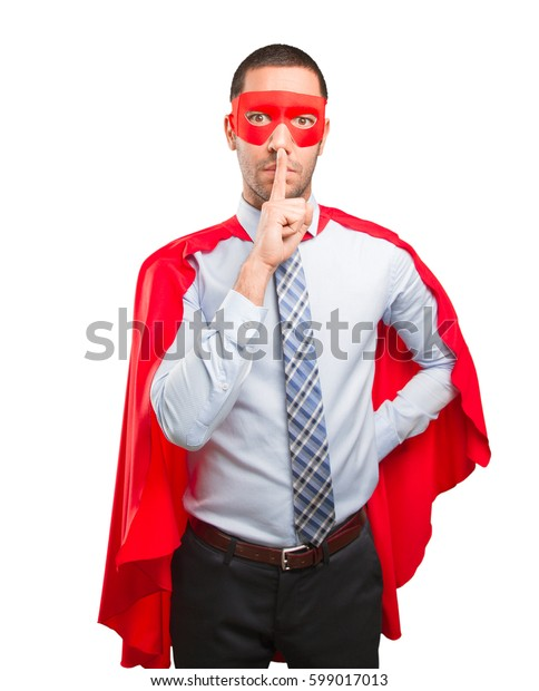 Serious super businessman silence gesture