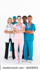 Serious team of doctors looking at the camera with folded arms