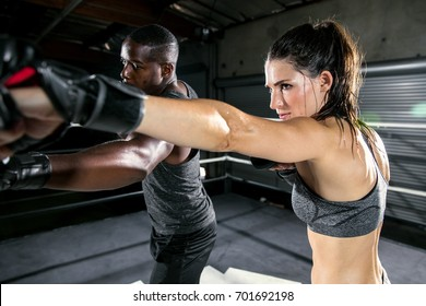 Serious tough strong female in a boxing class to build stamina and self defense strategy