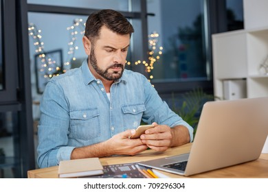 Serious troubled man checking his messages