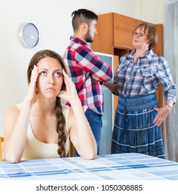 Serious unhappy mature mother having conflict with their upset children