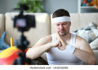 Serious Vlogger Doing Exercise for Hands on Camera. Sportsman Record Fitness Video on Digital Camera for Sport Vlog. Man Training Arms Muscles. Male Practice Aerobic. Workout for Body Warmup