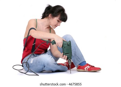 a serious woman working with a drill. white background