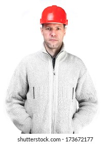 Serious worker man in a red helmet and jacket