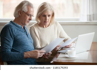 Serious worried senior couple calculating bills to pay or checking domestic finances stressed of debt, retired elderly old family reading documents concerned about loan bankruptcy money problems