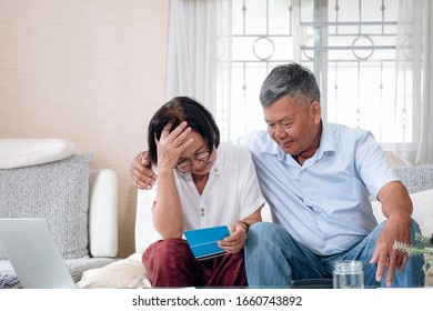 Serious worried senior couple calculating bills to pay finances stressed of debt and money problems.