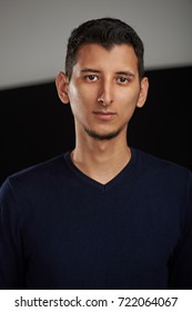 Serious young arab man on black and white background
