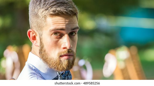 Serious young bearded man outdoor