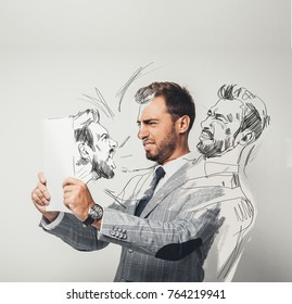 serious young businessman pretending drawing himself with pencil