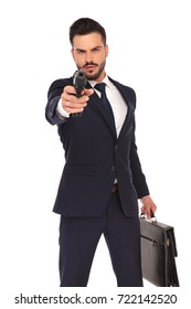serious young hitman pointing and aiming his gun to the camera on white background