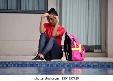 Serious Young Person Sitting