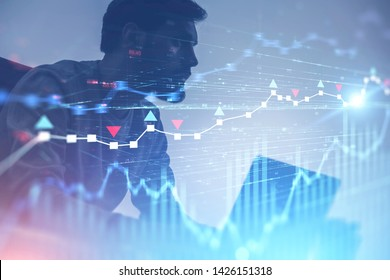 Serious young trader with beard working with laptop over white background with double exposure of forex charts. Concept of start up and stock market. Toned image blurred
