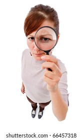 Serious young woman looking through magnifier lens as detective, analyzing or finding something