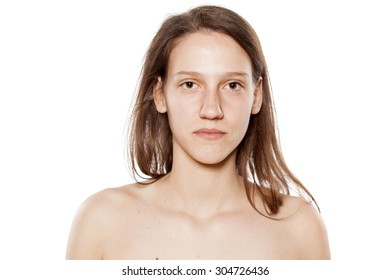 serious young woman without make-up on white background