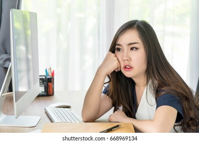 seriously asian woman in office - business concept