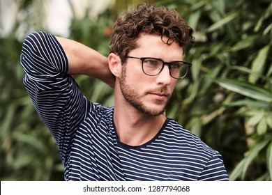 Seriously handsome guy in glasses, looking away