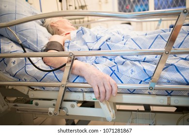 seriously ill old woman on a functional bed in the hospital, in the intensive care unit