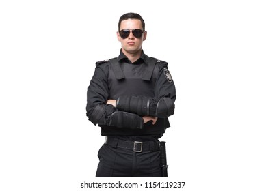 Seriuse cop in sunglasses, uniform with body armor