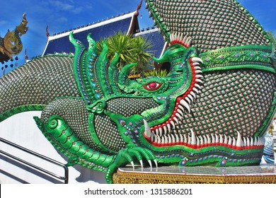 The serpent swallowed each other. Naga eating towards each other. Naga eat each other. Great naga statue, King of nagas,Serpent. Naga statue at Banden temple, Chiang Mai. Thailand.