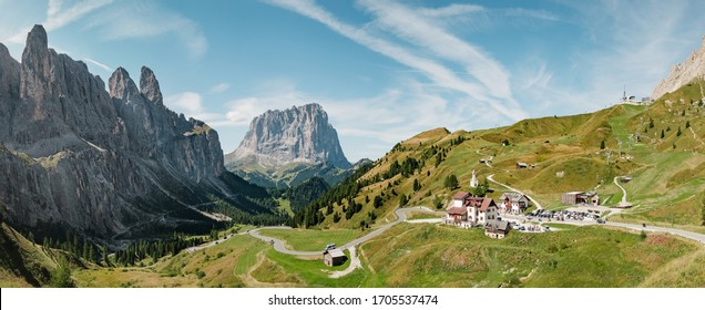 Serpentine in the Italian Alps mountains. Gardena pass,Passo Gardena, Rifugio Frara, Dolomiti, Dolomites, South Tyrol, Italy, UNESCO World Heritage. Aerial amazing shot. View from above.
