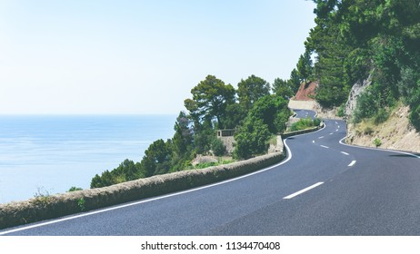 Serpentine road and amazing view of sea and mountain landscape in a sunny day on tropical island. Road adventure trip on the Canary Islands.Wide