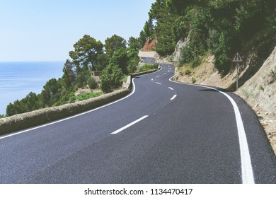 Serpentine road and amazing view of sea and mountain landscape.