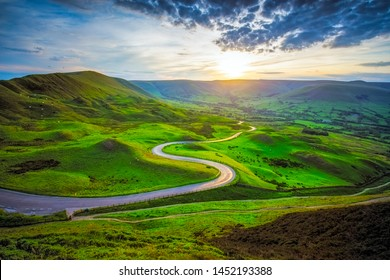 Serpentine Road Among Green Hills of Peak District National Park in Uk.