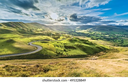 Serpentine Road Among Green Hills of Peak District National Park