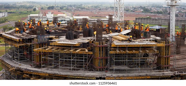 Serpong, Banten / Indonesia - November 16 2016: The building of tower D at Universitas Multimedia Nusantara (UMN). People with yellow hard hat works on top of the unfinished building